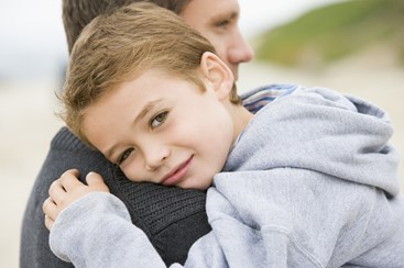 shutterstock 17813668%5b1%5d ras h2 father holding son close