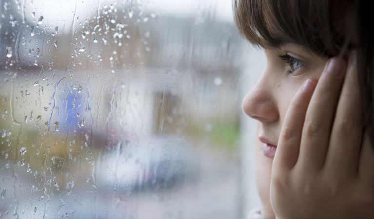 copy of shutterstock 23398030%5b1%5dyoung child looking window rain